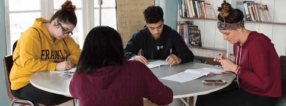 students collaborating at a round table
