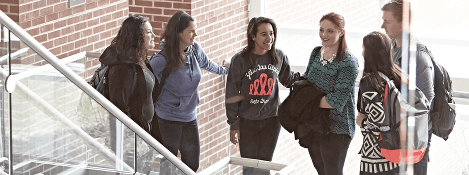students talking in stairwell