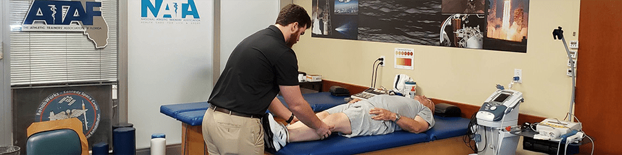MSAT - Zac at NATA examining patient