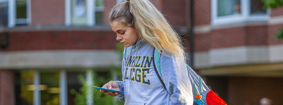 Student looking down at cell phone
