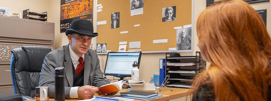Professor sitting across the desk from student