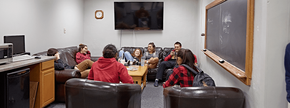 Group of students hanging out in common room of dorm