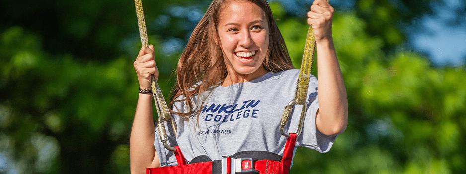 Female student swinging in bungee swing